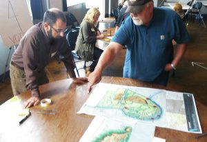 Courtesy of The Daily Herald. Equinox' David Tuch works with community member at design charrette